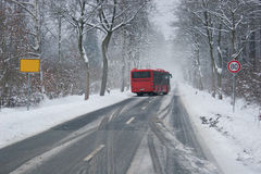 Bus at a slippery winter road Royalty Free Stock Image