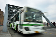 Bus Speeding. Through the Waibaidu Bridge which is  the first all-steel bridge and the only surviving example of a camelback truss bridge, in China Royalty Free Stock Photography