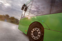 Bus speeding out of a city Royalty Free Stock Photos