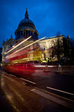 Bus by St Paul's at twilight. A bus speeding past St Paul's Cathedral, London, at twilight Royalty Free Stock Photography