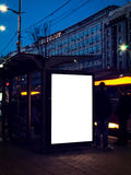 Bus station. Blank billboard on the bus station in long  exposure Stock Photo