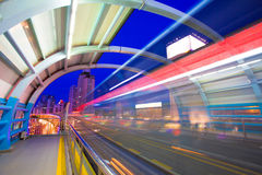 Bus through station with blur light. At night Stock Image
