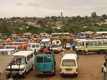Bus station, Ghana, Africa. Bus buses station stop rural small town city sunyani trucks passengers poor travel transport transportation stock images