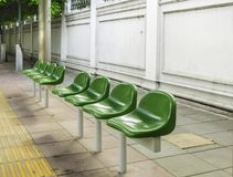 Bus station with green plastic seats Stock Photography