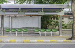 Bus station with green plastic seats Stock Photos