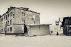 Bus station with New Year firtree and house in Teriberka, Murmansk Region, Russia Royalty Free Stock Photo