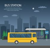 Bus station, night. Bus at the bus stop on background of city. Transport concept of passenger transportation Royalty Free Stock Photos