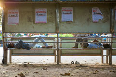 Bus station. Sleeping on the street people of India royalty free stock image