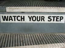 Bus Steps- Watch Your Step!. Sign on school bus steps. Reads Watch Your Step Royalty Free Stock Images