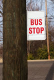 Bus stop. A bus stop sign on a telephone pole stock photography