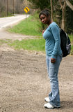 Bus Stop. A teenage girl waiting for the school bus Stock Images