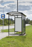 Bus stop with the ad Stock Images