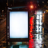 Bus stop advertising billboard. Blank bus stop advertising billboard in the city at night royalty free stock photo