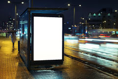 Bus stop advertising billboard. Blank bus stop advertising billboard in the city at night royalty free stock image