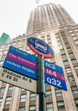 Bus stop against tall buildings, New York City.  Stock Photo