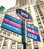 Bus stop against tall buildings, New York City.  Royalty Free Stock Photos