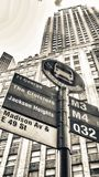 Bus stop against tall buildings, New York City.  Stock Image