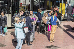 Bus stop in Barcelona. Barcelona, Spain - November 7, 2014: Group of newcomers tourists to Barcelona at a bus stop in Barcelona, Spain on November 7, 2014 Stock Photo
