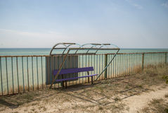 Bus stop on the beach Stock Image