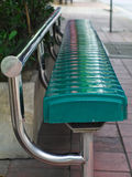 Bus stop bench. Closeup shot of metallic bus stop bench painted in green stock image