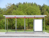 Bus stop with a billboard stock photos