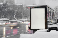 Bus stop billboard in the city stock photography