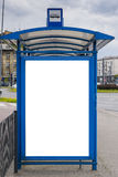 Bus stop with a billboard royalty free stock image