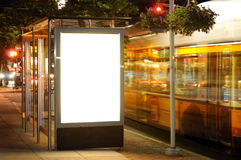 Bus Stop Billboard at Night. Bus passing by royalty free stock images