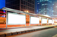 Bus stop billboard at night Stock Images