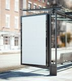 Bus stop with blank ad banner. 3d rendering. Bus stop with blank ad banner on the street. 3d rendering Royalty Free Stock Photo