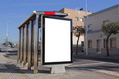 Bus stop with blank advertisement Stock Photo
