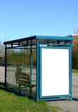 Bus stop with blank bilboard. A bus stop with a blank bilboard for your advertising Stock Photos