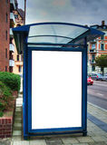 Bus stop with blank bilboard HDR 02. A high dynamic range image of a bus stop with a blank bilboard for your advertising Royalty Free Stock Photo
