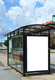 Bus stop with blank bilboard HDR. A high dynamic range image of a bus stop with a blank bilboard for your advertising Stock Images