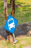 Bus Stop. Blue bus stop against a tree Royalty Free Stock Images