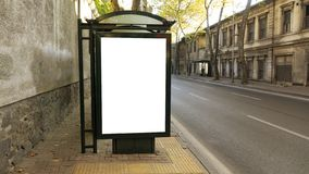 Bus stop in city with empty white mock up banner for advertising royalty free stock photo