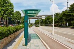 Bus stop. City bus stop at road side of city street Royalty Free Stock Photography