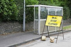 Bus stop closed sign road works no public transport cancelled emergency repair. Uk stock photos
