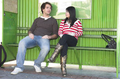 Bus stop couple Royalty Free Stock Images
