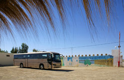 Bus stop in desert. The bus costs on a platform at road service station in desert Royalty Free Stock Images