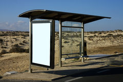 Bus stop in desert. Blank advertising billboard on the bus stop Royalty Free Stock Photo