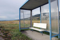 Bus stop enclosure in a rural setting. Stock Images
