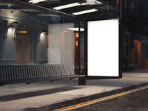 Bus stop with a glowing blank banner on the street. 3d rendering. Bus stop with a glowing blank banner on the dark street. 3d rendering Royalty Free Stock Image