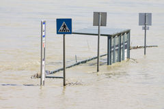 Bus stop in heavy flood Stock Photography