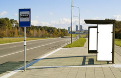 Bus stop on a  highway  near to a megacity. Bus stop on a high-speed  highway near to a megacity. Solar autumn day Royalty Free Stock Images
