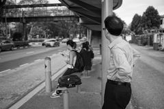 Bus Stop. A man is waiting the bus on the bus stop Royalty Free Stock Image