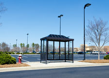 Shopping center bus stop. Bus stop near large parking lot at the shopping area Royalty Free Stock Image