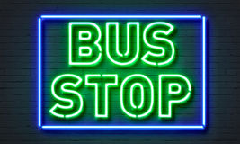 Bus stop neon sign on brick wall background. Stock Photo