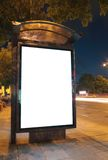 Bus stop at night. Blurred light from the passing vehicles are visible. This is for advertisers to place ad copy samples on a bus shelter royalty free stock photos