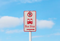 The bus stop and no parking sign with blurry blue sky background Royalty Free Stock Photos